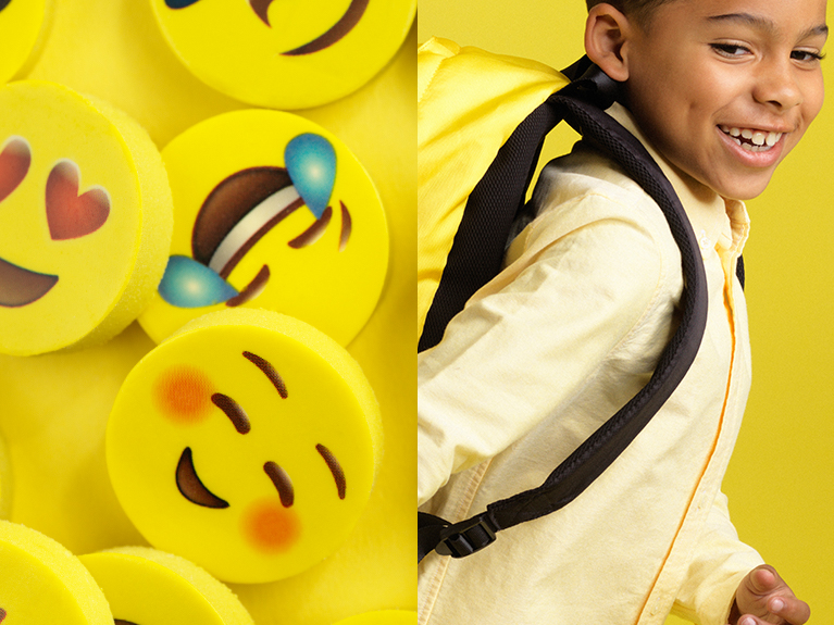 Square image with a yellow background featuring yellow smiley faces and a boy wearing a yellow backpack